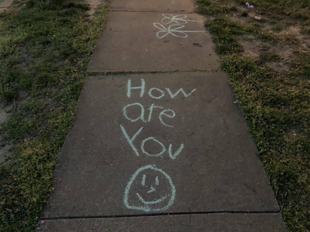 A chalk message on a sidewalk in Arlington.