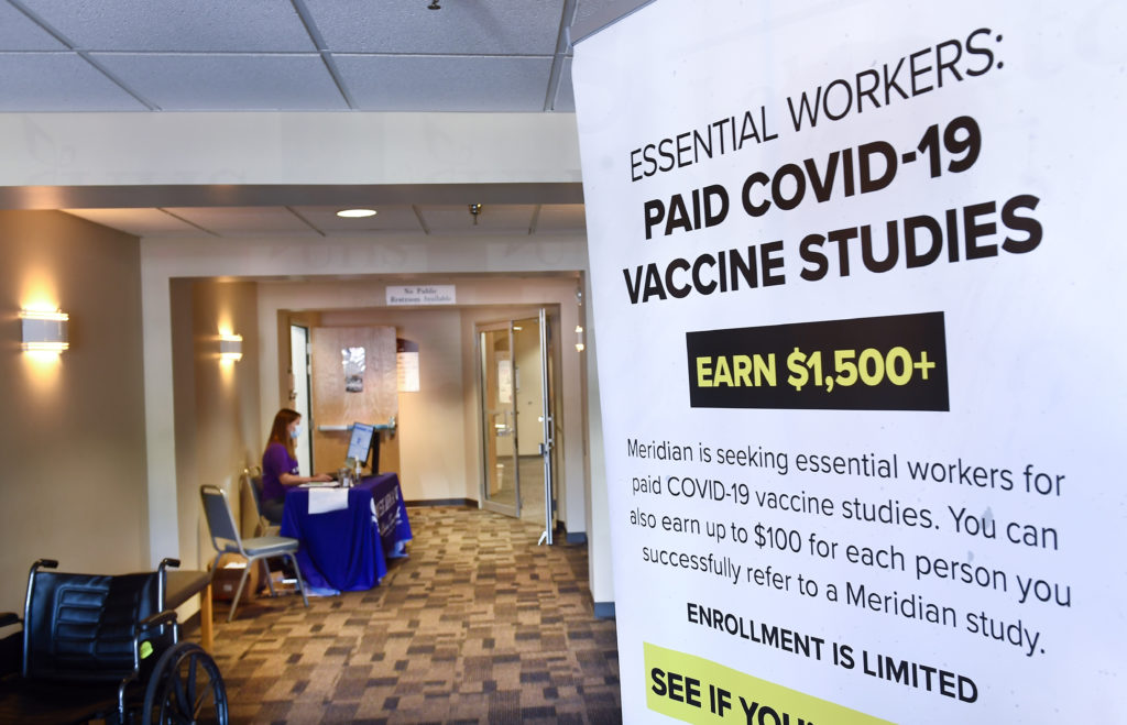 A poster is displayed in the entrance way looking for volunteers as the world's biggest study of a possible COVID-19 vaccine, developed by the National Institutes of Health and Moderna Inc.,  gets underway in late July.