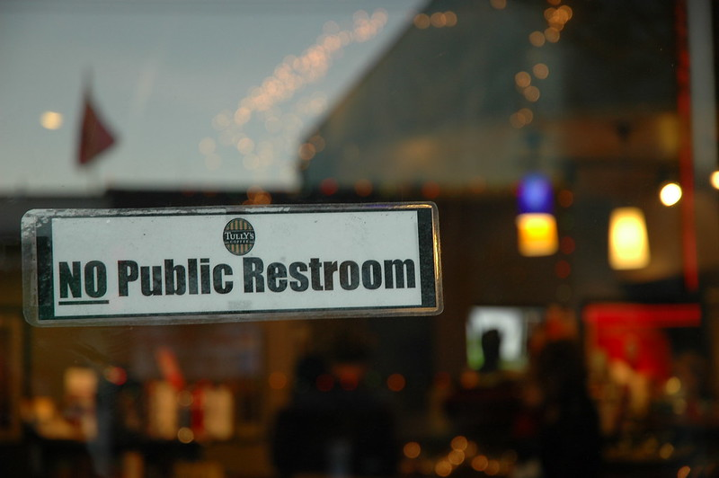 A sign in the window of a Seattle  coffeehouse, December 26, 2009. Locals and tourists alike complain that the District is short on public restrooms. The problem is a daily one for people experiencing homelessness.