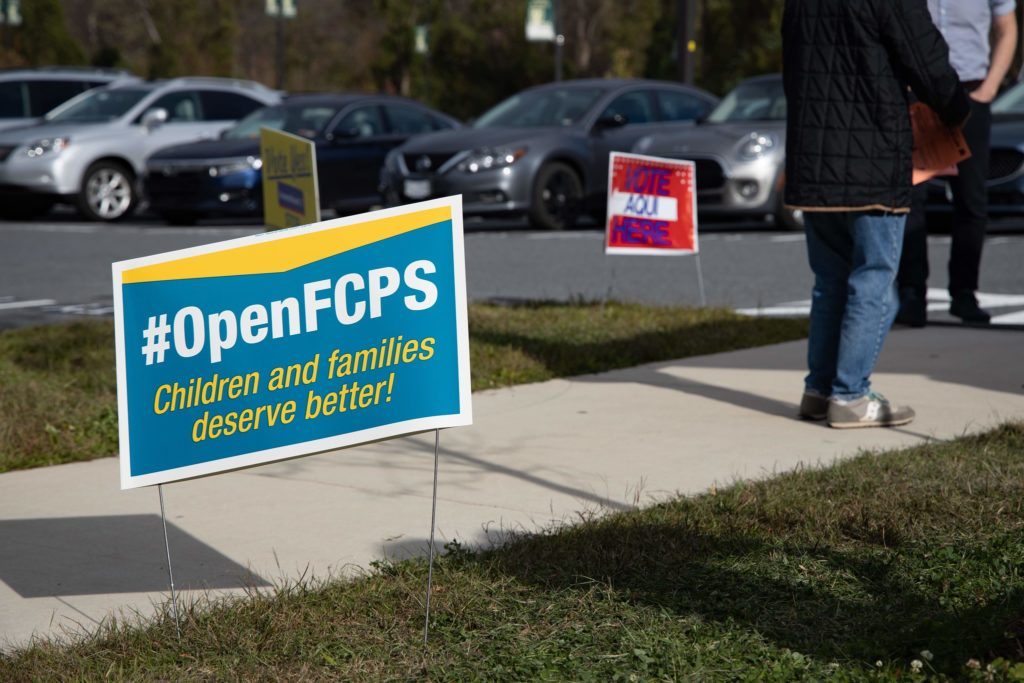 A sign outside Langley High School in Fairfax County on election day calls for Fairfax County Public Schools to open.