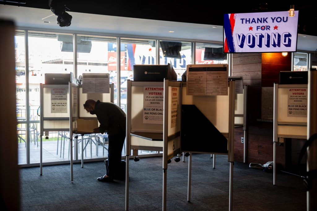 A voter casts a ballot at the polling place at Nationals Park in Washington, D.C. on November 3, 2020.