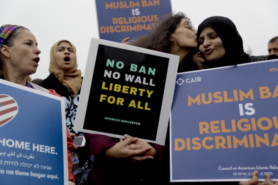 Supporters of immigrants and refugees gathered outside the Supreme Court before arguments over the Trump Administration's travel ban.