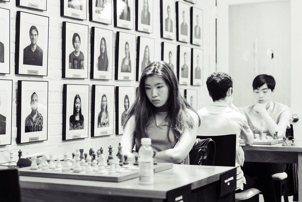 Jennifer Yu contemplates a move at the 2019 U.S. Junior Chess Championship in St. Louis.