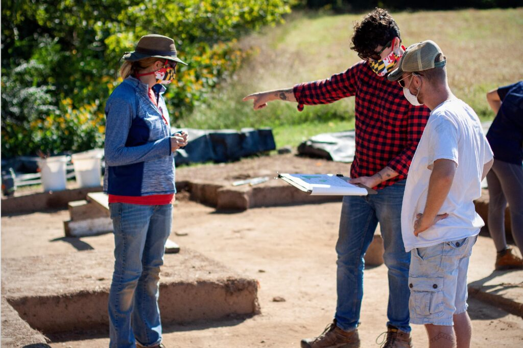 Archaeologist Travis Parno (center) led the St. Mary's Fort excavation. He joins us to discuss the recently uncovered site.
